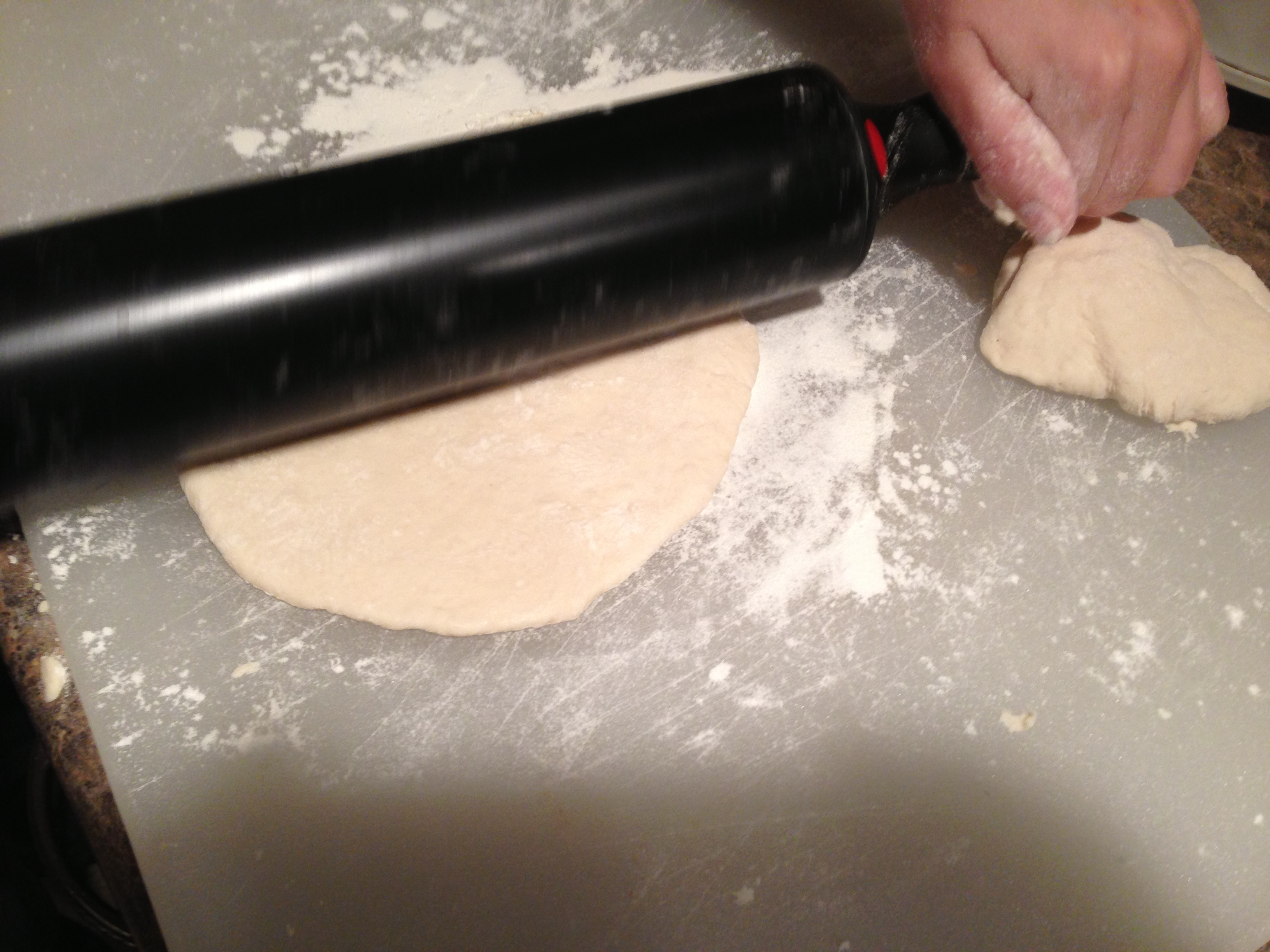 How to Roll Homemade Pita Bread by aurorameyer.com